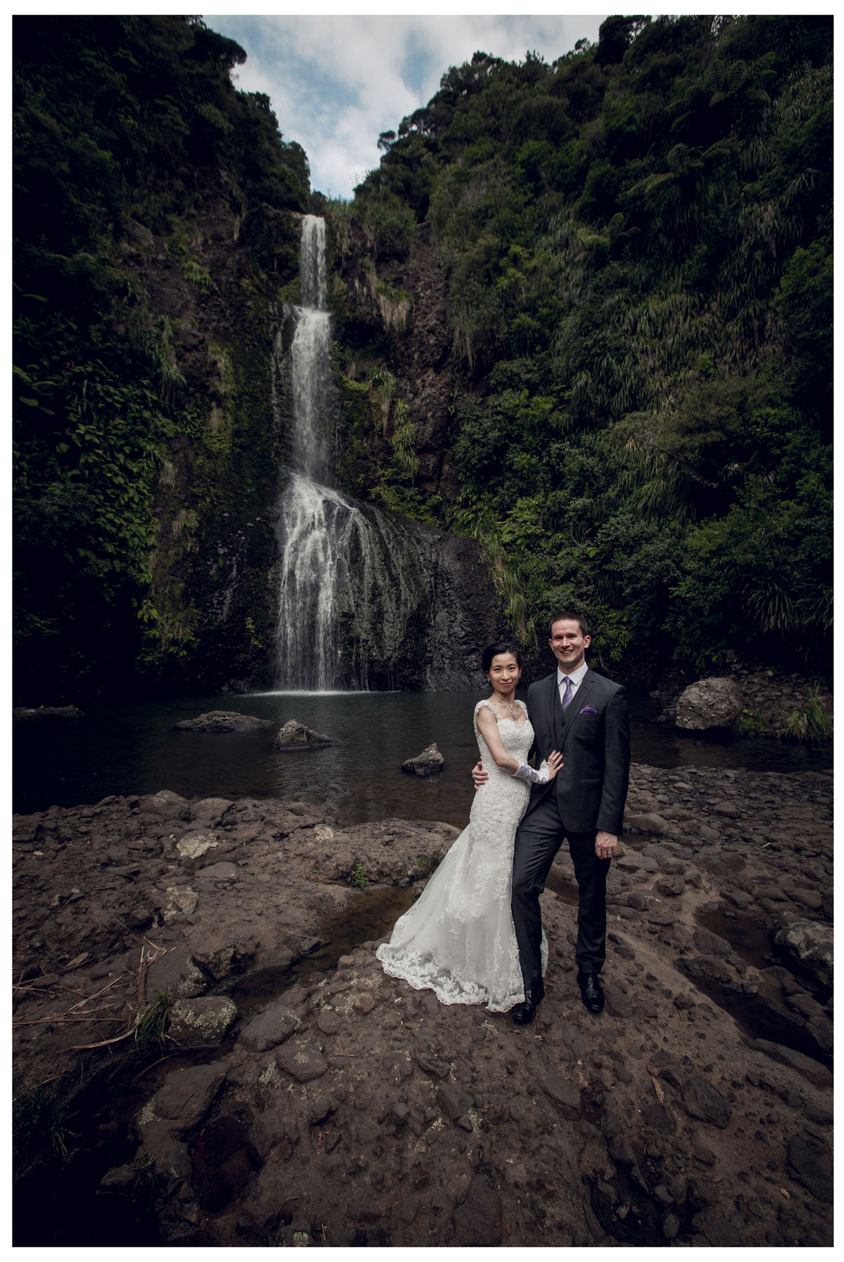 wedding photograph by Auckland wedding photographer Chris Loufte www.theweddingphotographer.co.nz Kitekite waterfall