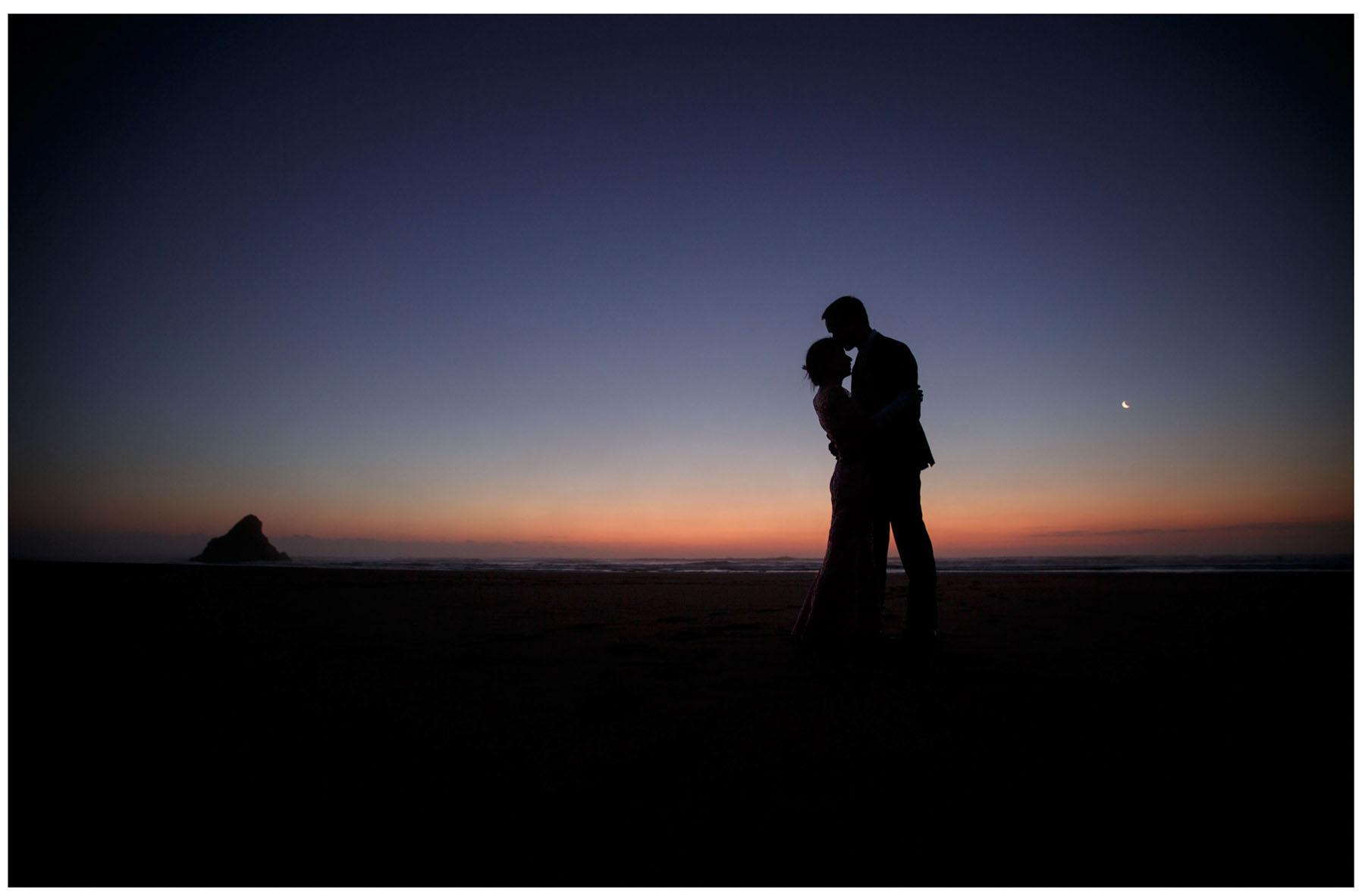 wedding photograph by Auckland wedding photographer Chris Loufte www.theweddingphotographer.co.nz Kitekite waterfall