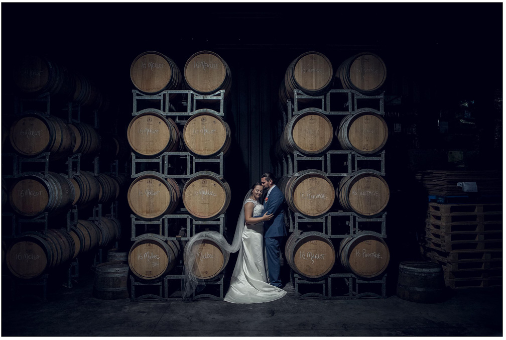 Soljan's Estate winery Auckland wedding photo in the barrel room