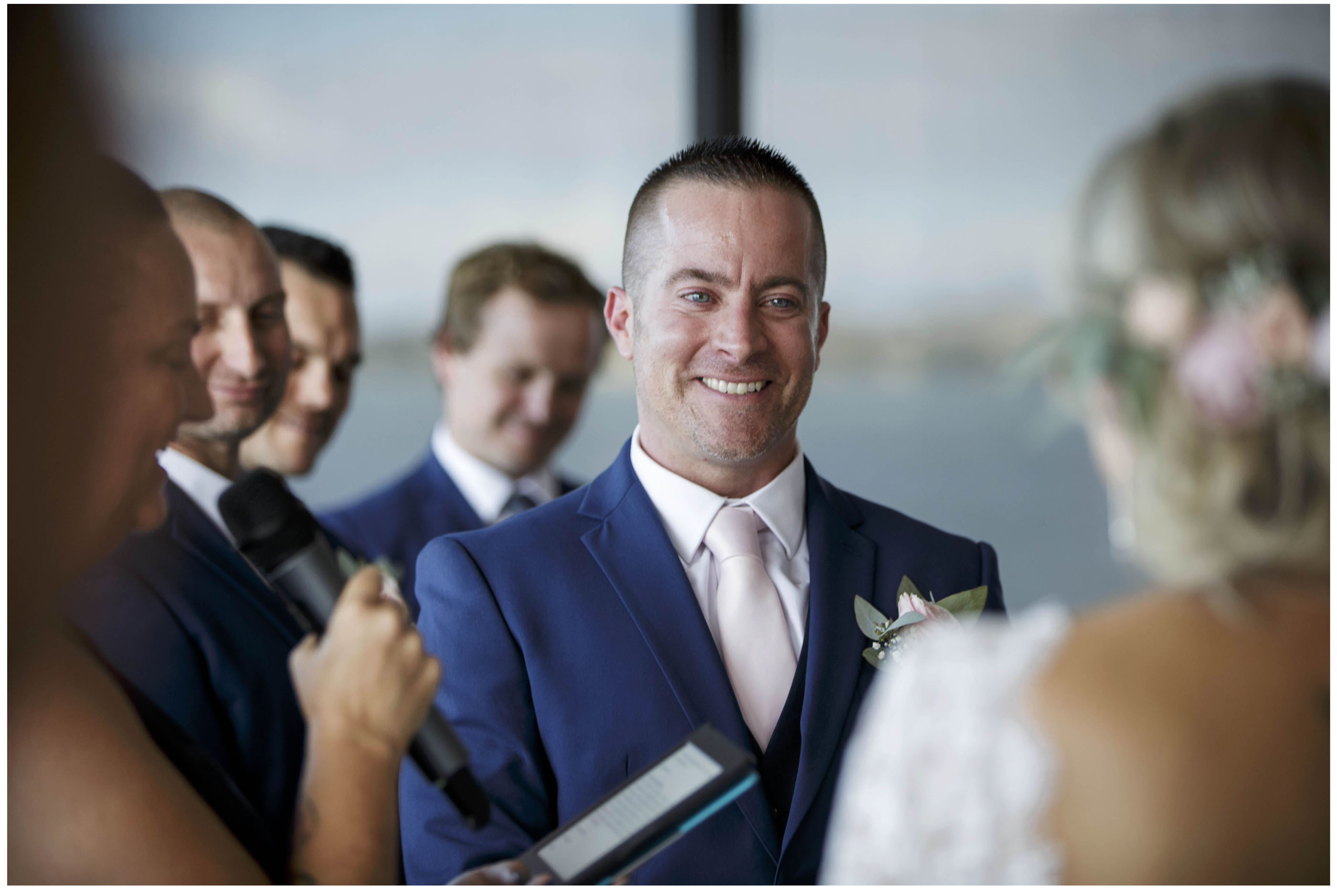 Groom smiles at bride, wedding ceremony at Five Knotts Auckland, Auckland Wedding Photographers