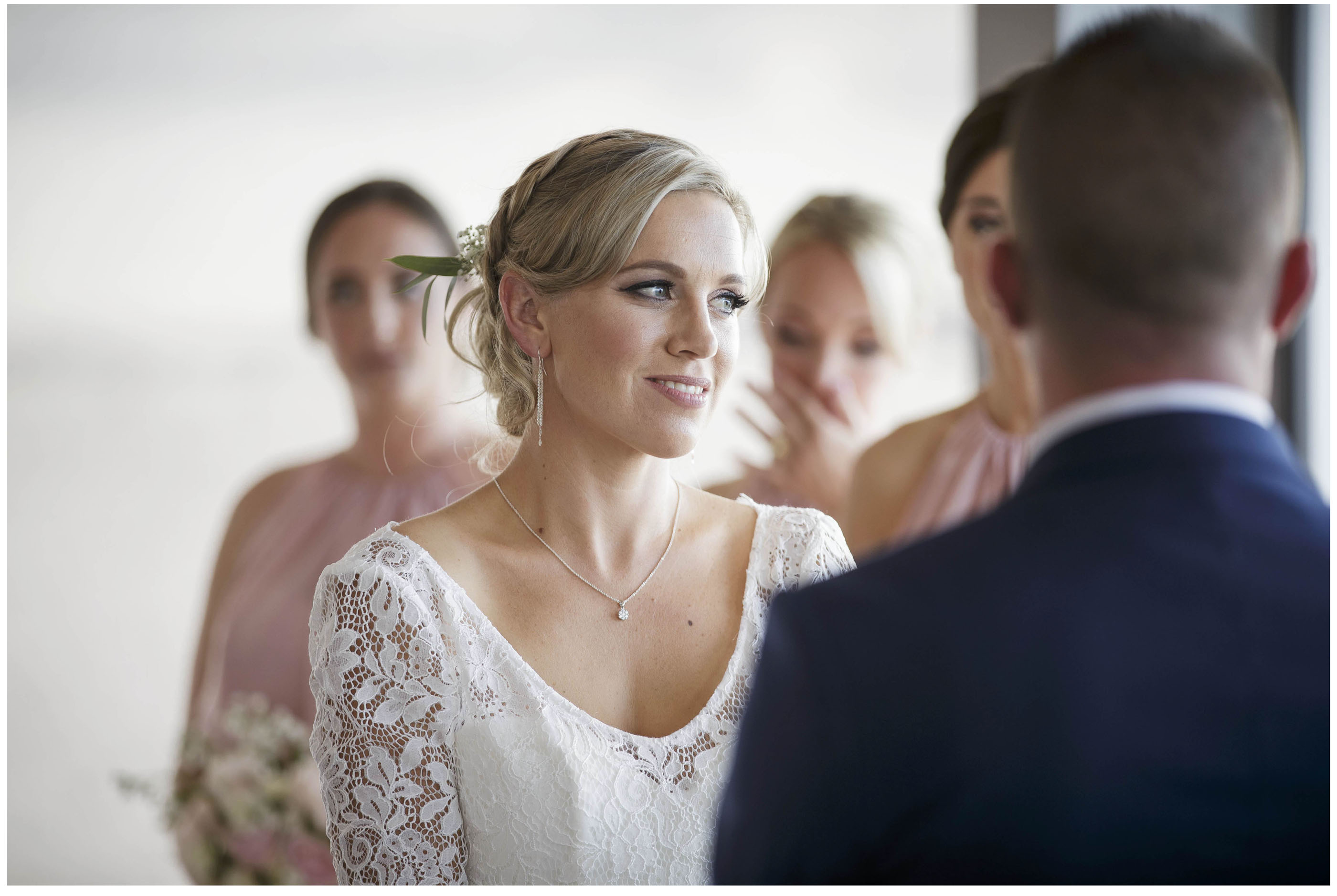 Bride in white lace wedding dress at wedding ceremony, Five knotts Wedding venue Auckland, Auckland Wedding Photographers