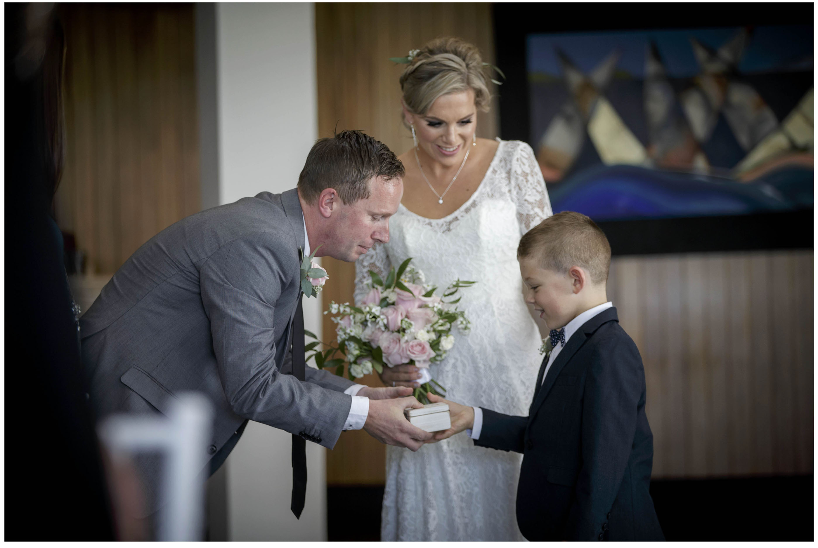 PAge boy gives wedding rings to best man, Wedding ceremony, Five Knotts Auckland, Auckland Wedding Photographers