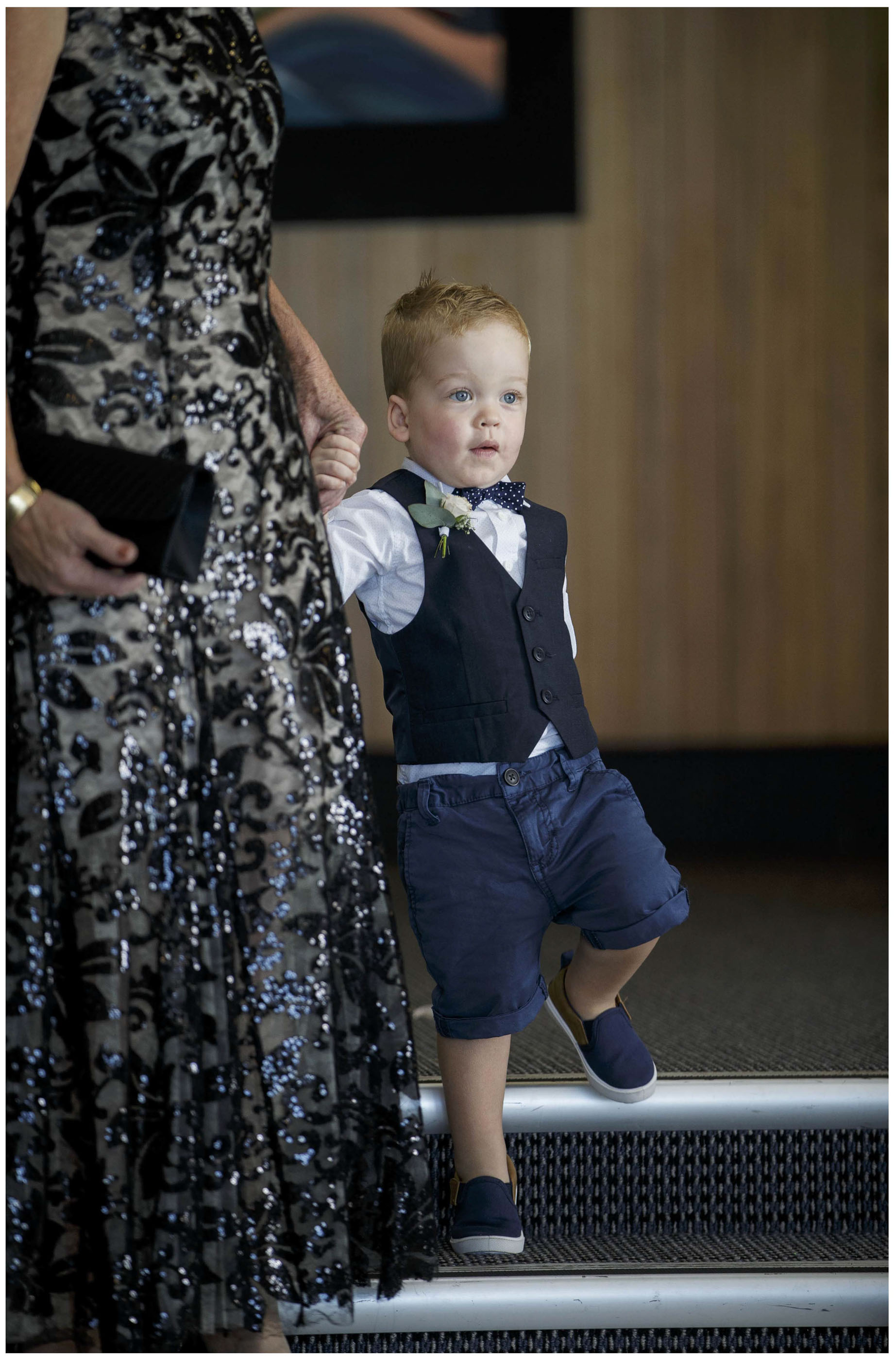 Pageboy wlks down the isle, Five Knotts Wedding, Auckland Wedding Photographes,