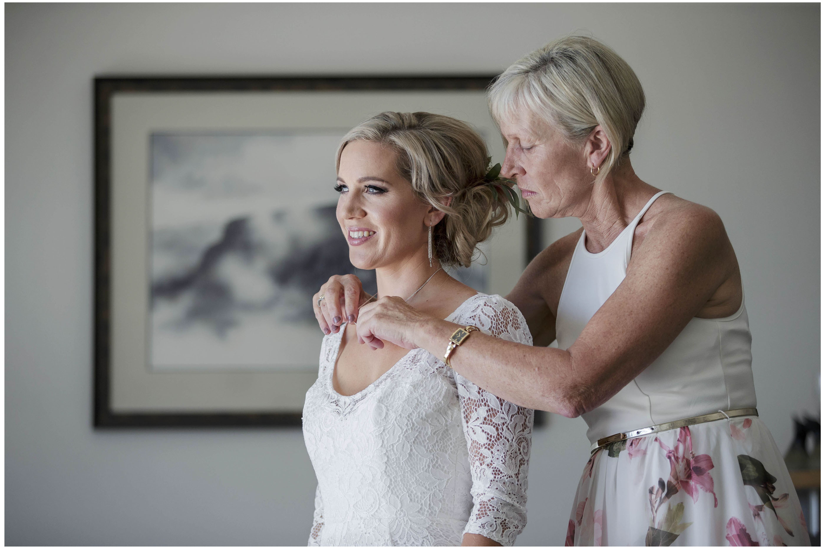 Moth of the bride places wedding jewellery on the bride , Auckland wedding photographers, Five Knotts Wedding