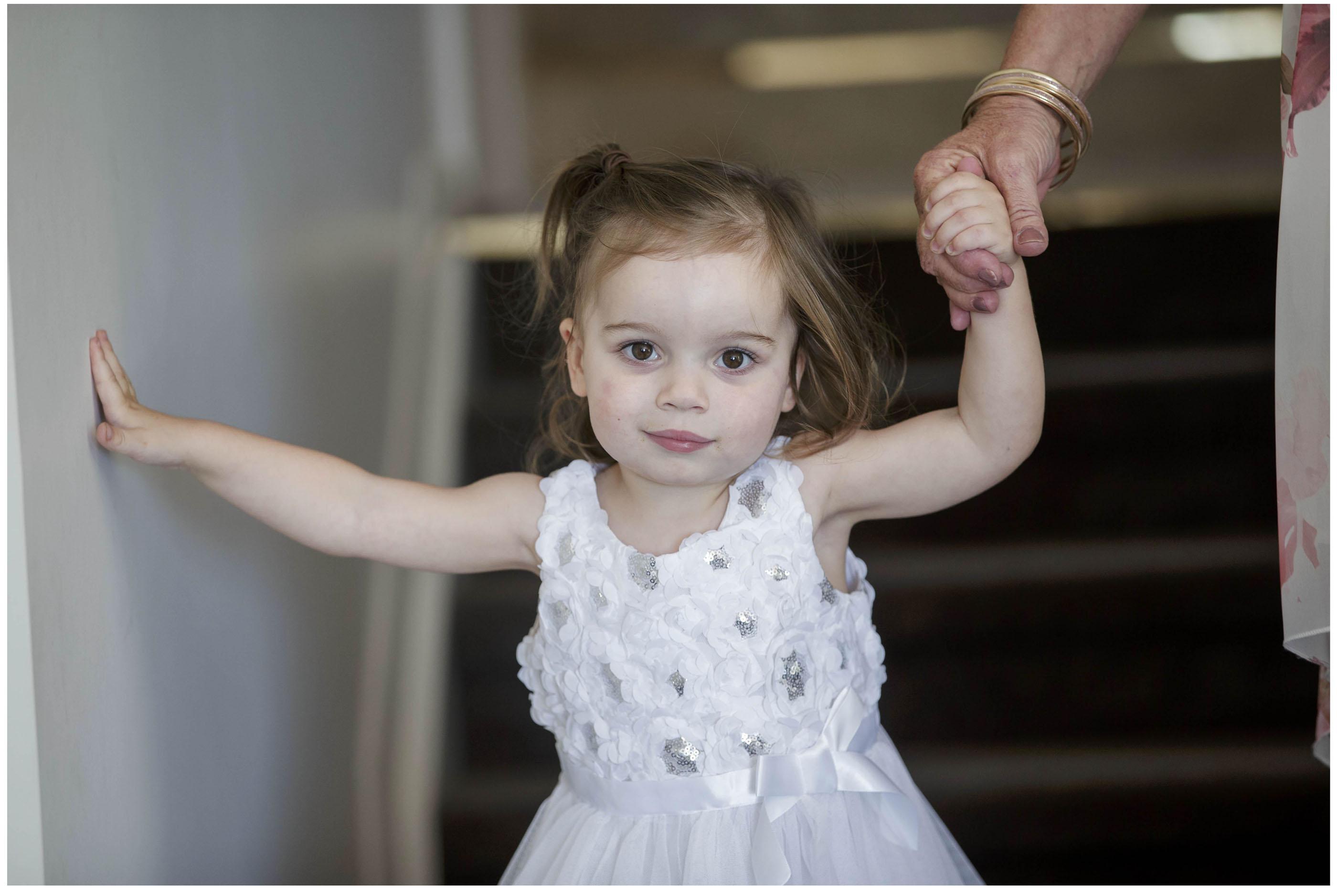 Cute flower girl in her flowergirl wedding dress, Auckland Wedding Photographers, Five Knotts Wedding