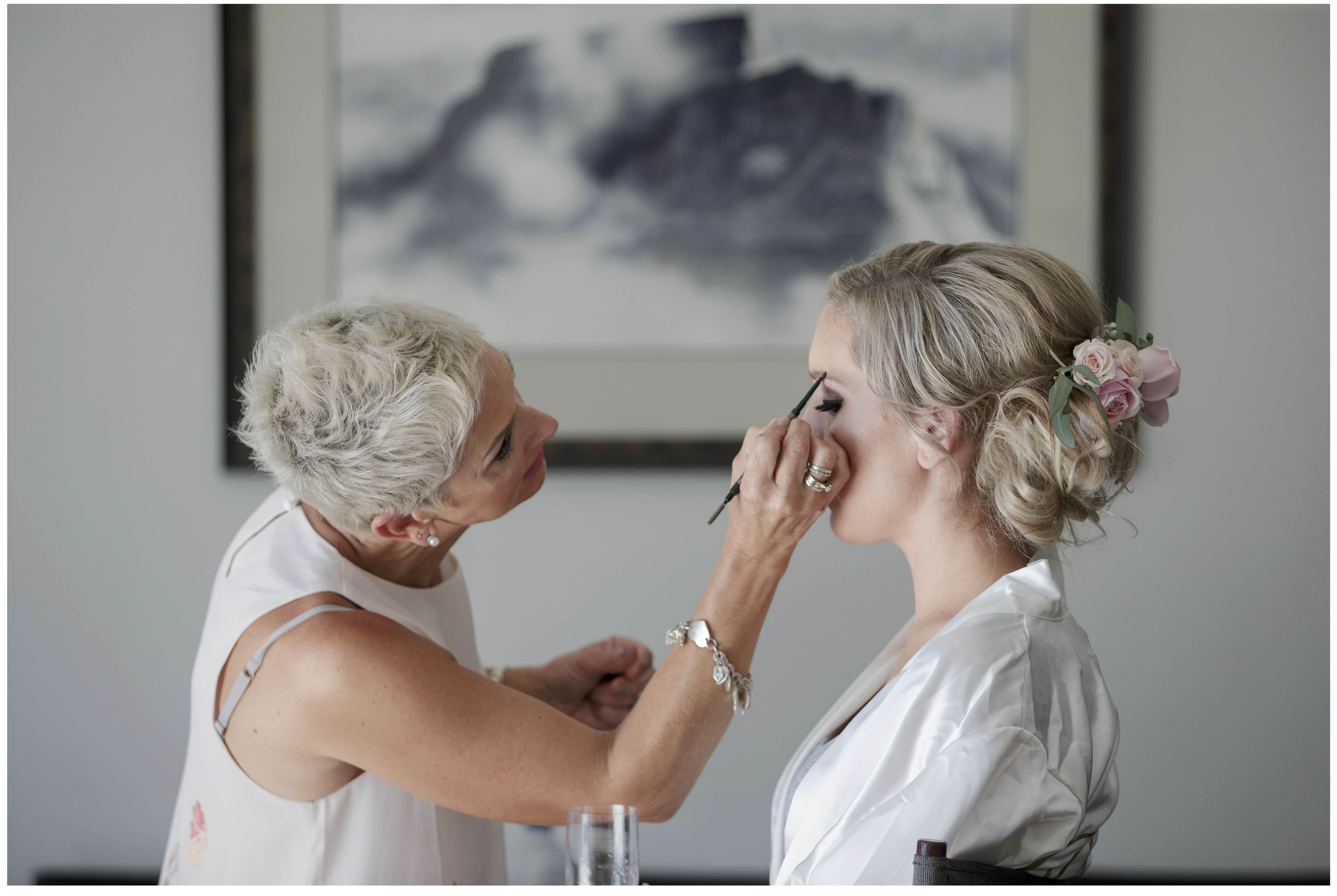Bride has her wedding makeup and haair styled, Flowers in brides hair, Auckland Wedding Photographers, Five Knotts Wedding Venue