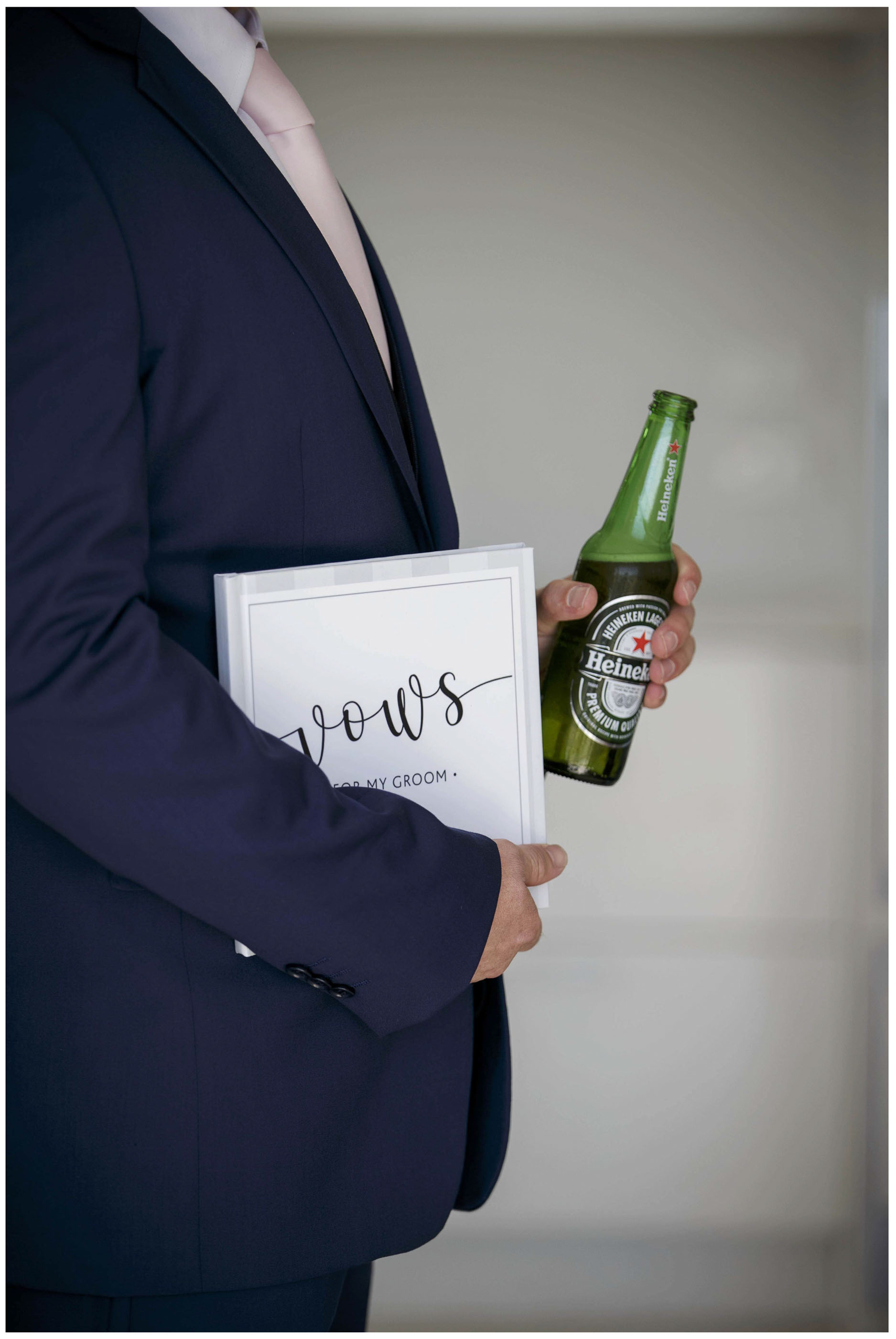 Groom Holds beer and wedding vows, Auckland wedding photographers, Five Knotts Wedding photo