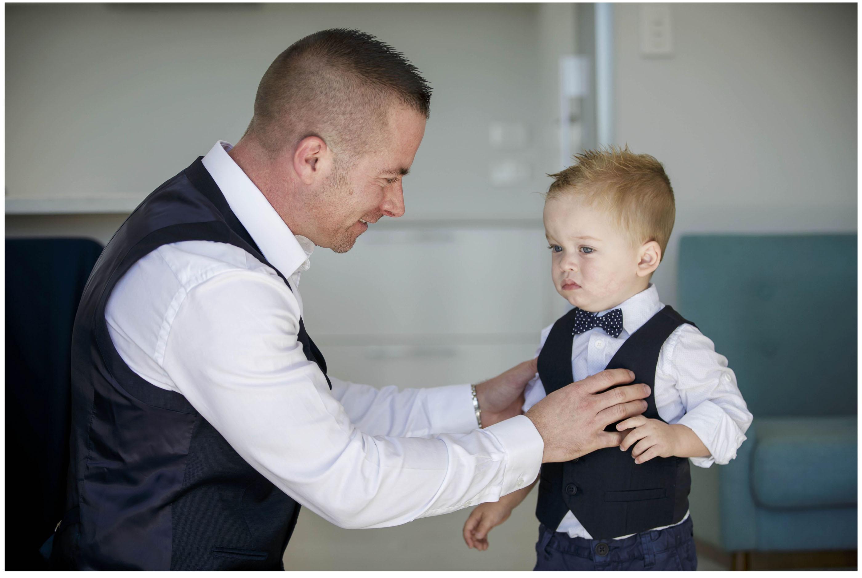 Groom Helps PageBoy Dress, Auckland Wedding Photographers, Five Knotts Wedding Photo
