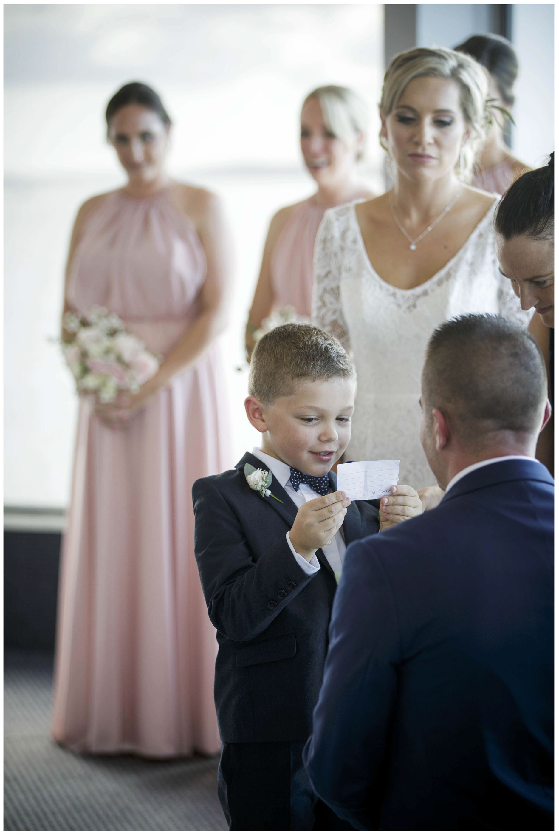 Pageboy reads out poem at wedding ceremony, Five Knotts weddign Auckland, Auckland wedding Photographers