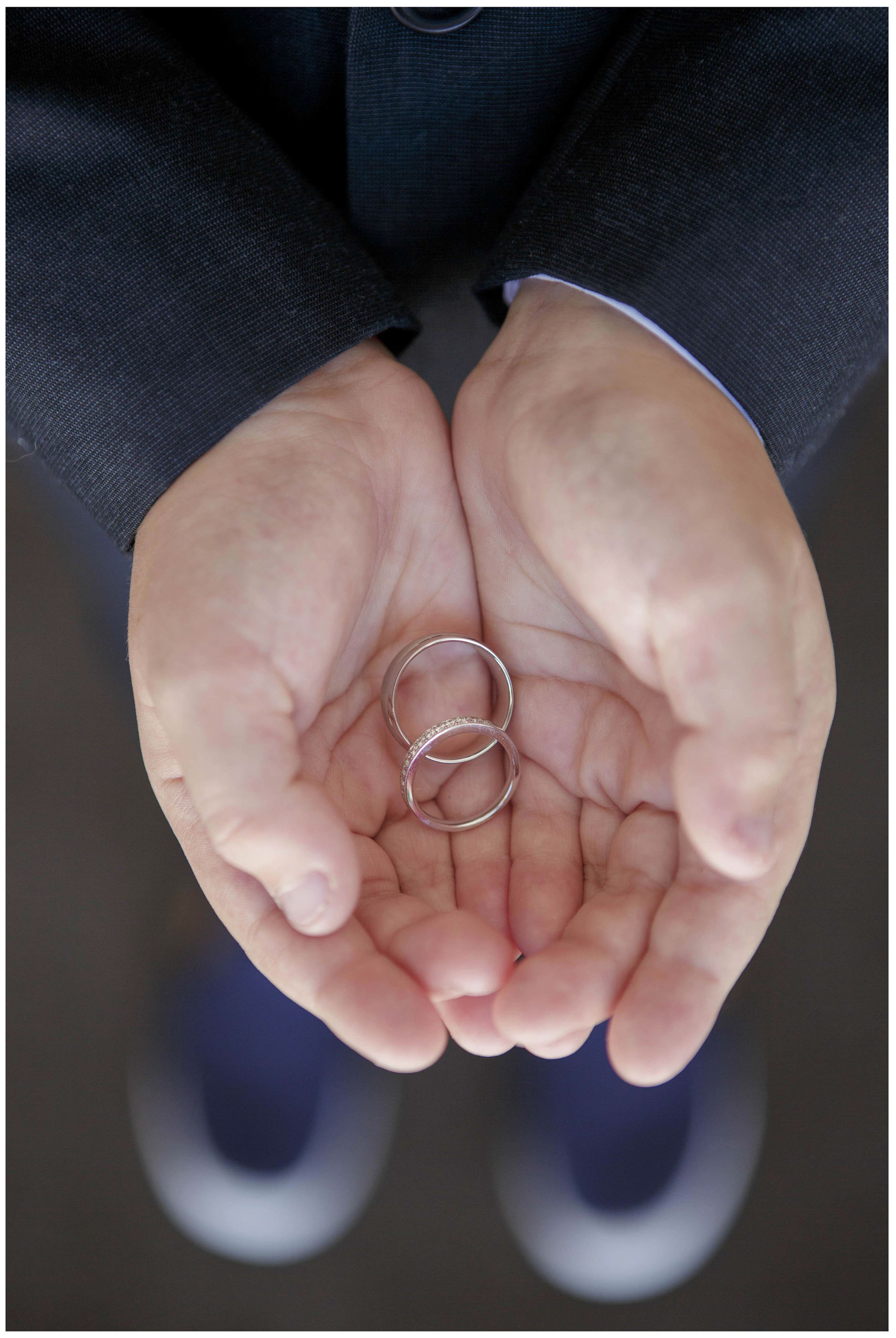 Wedding bands, wedding rings in the groom's cupped hands, Auckland Wedding Photographers, Five Knotts Wedding