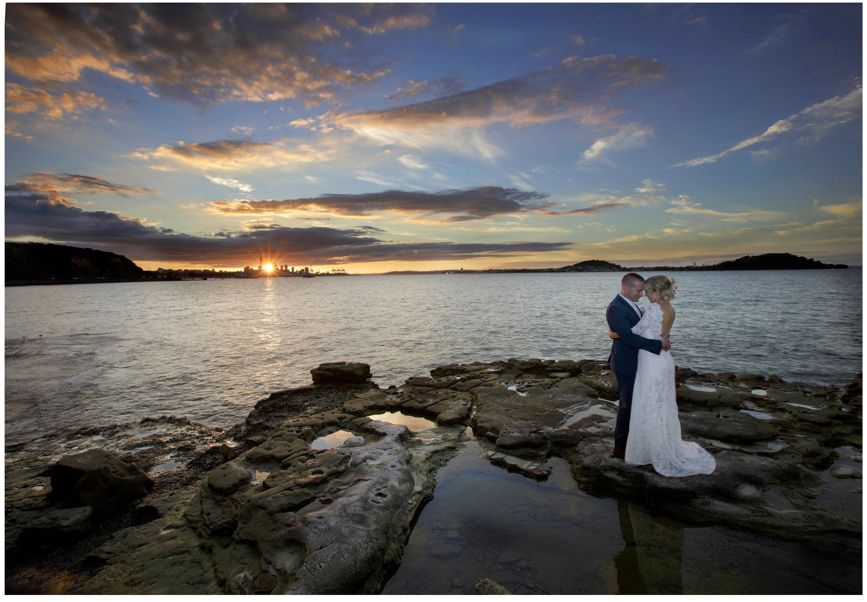 Sunset wedding photo of bride and groom in Auckland City, Auckland Wedding Photographers, Five Knotts Wedding Venue close by.
