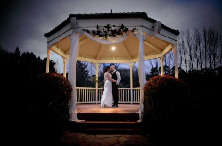 Bride and groom in rotunda at sunset at Gracehill WEinery.
