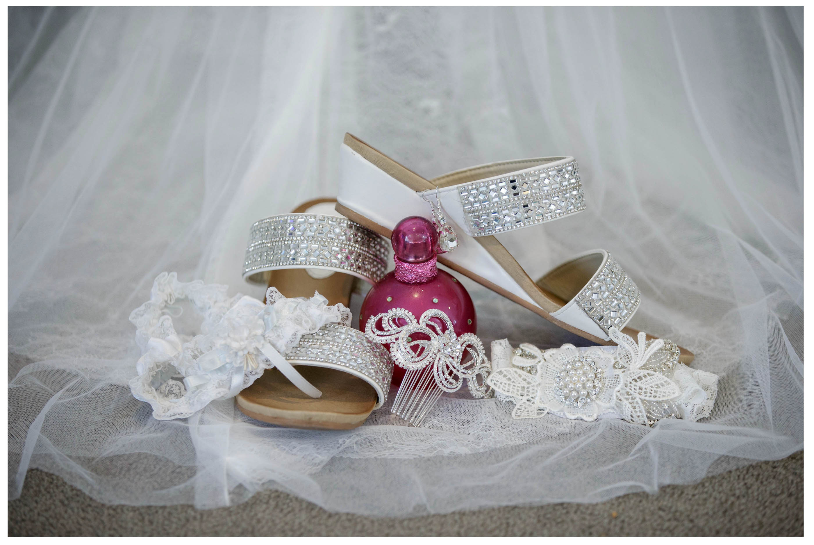 wedding shoes with perfume garter and dress