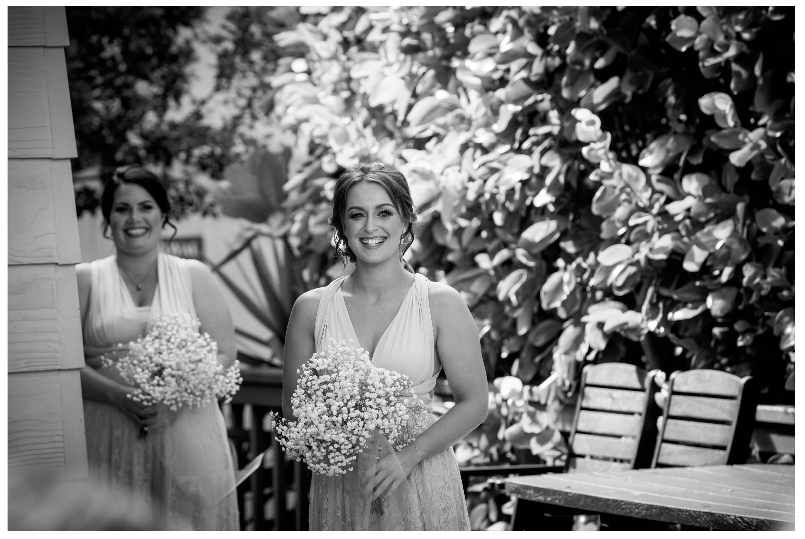 bridesmaid walks dowphoton isle. Black and white