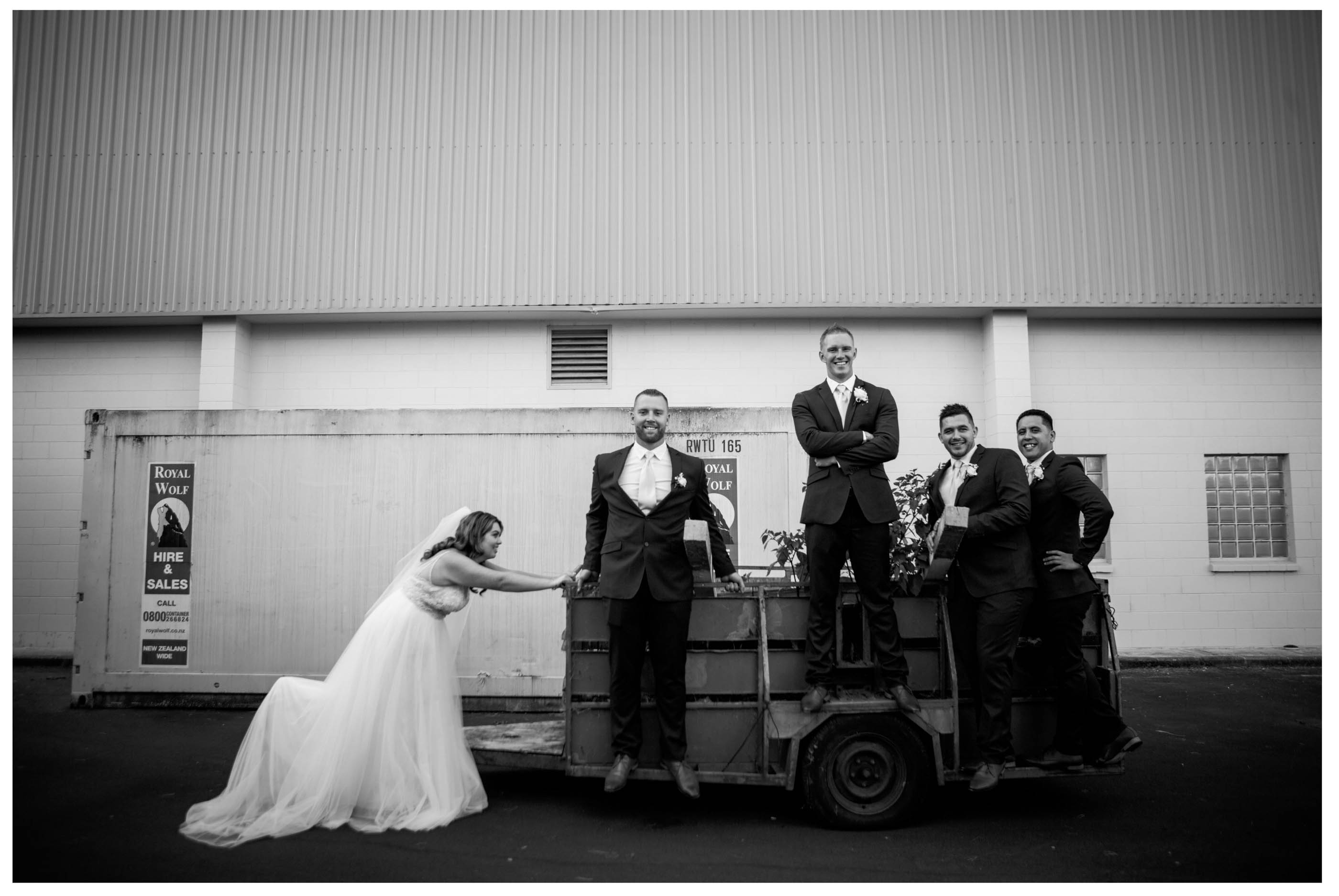 funny photo. Bride pushed trailer full with groom and groomsmen,